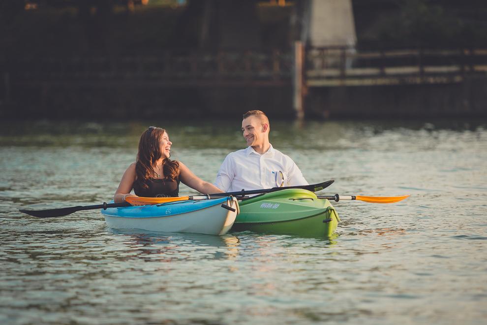 engagement photography of couple gazing in kayaks in buffalo ny