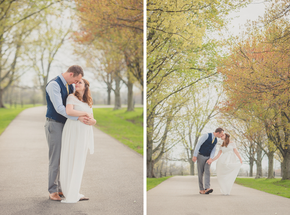 Photography of bride and groom kissing and snuggling on tree lined street at wedding at Knox Farm near Buffalo, NY