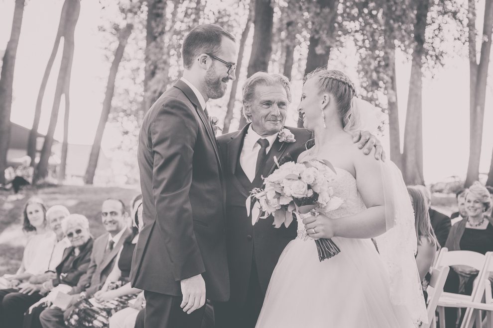 father gives daughter away at outdoor wedding ceremony at spring lake winery near Buffalo, NY