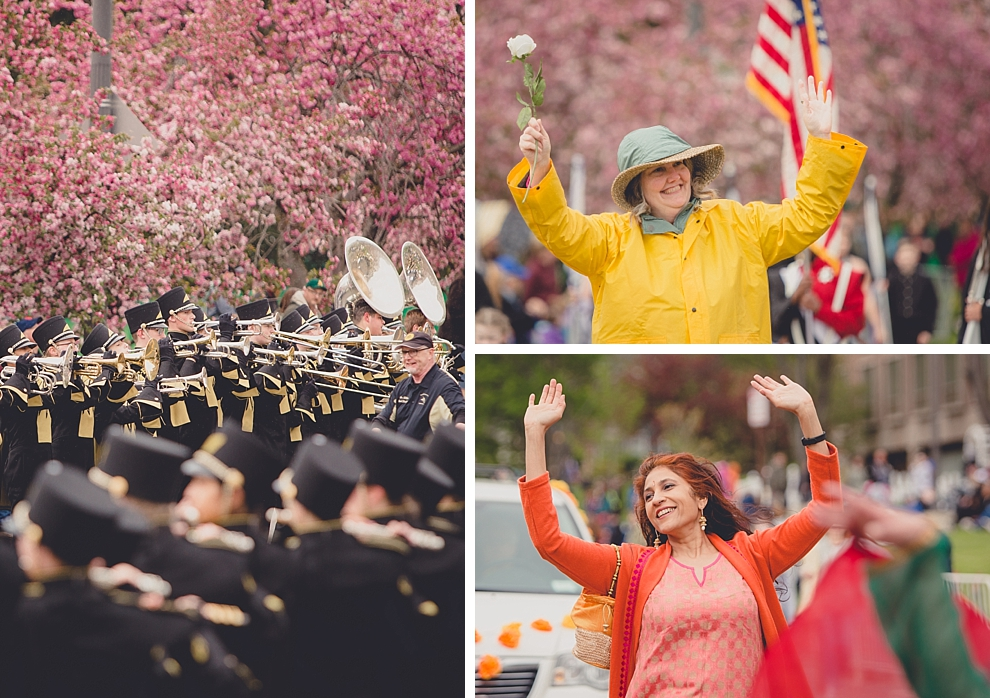 marching band and participants perform during parade in front of cherry blossoms Lilac Festival at Highland Park in Rochester, NY