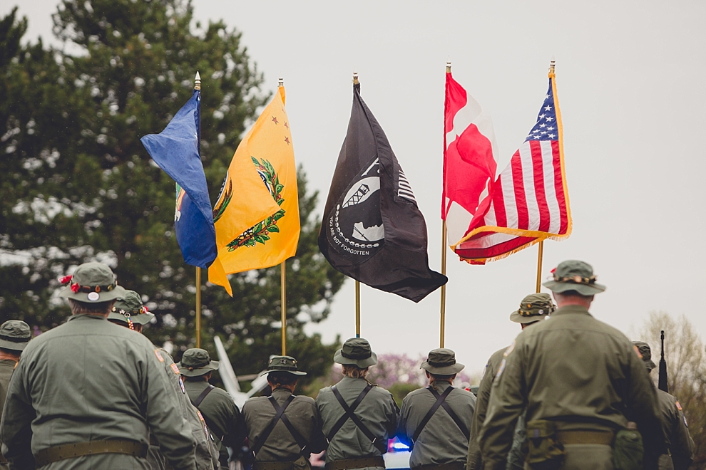 veterans march with flags during parade Lilac Festival at Highland Park in Rochester, NY