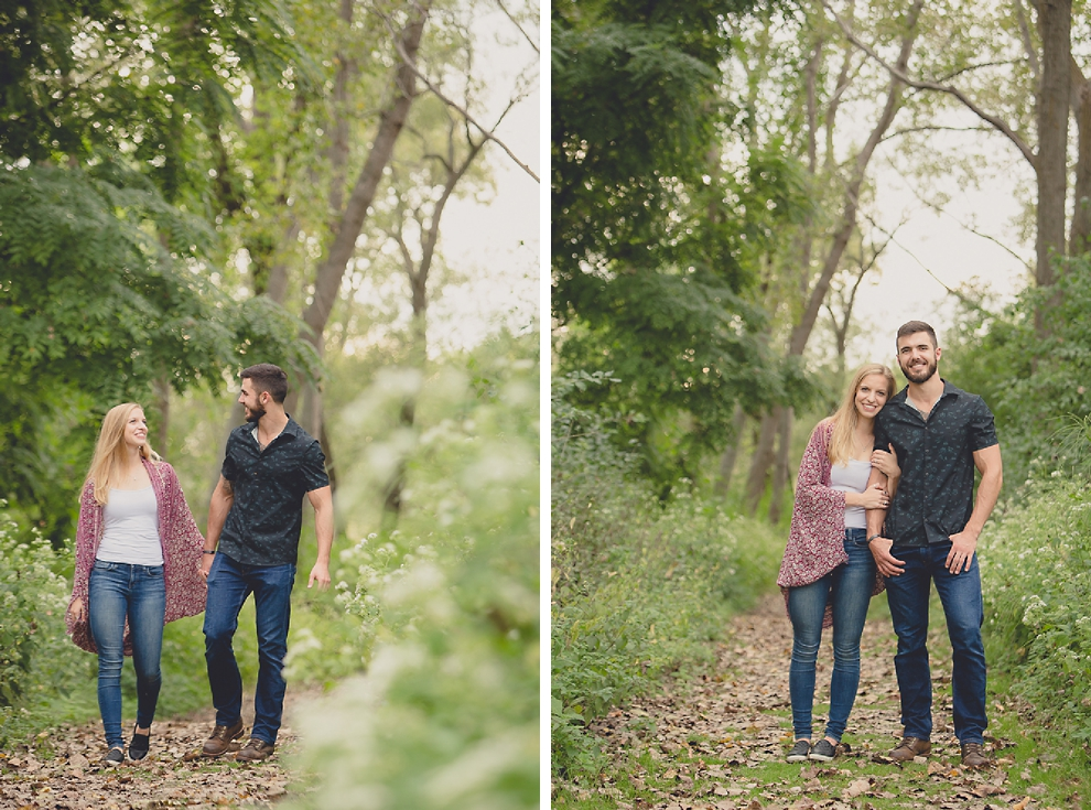 engagement photography of couple walking in in forest at Tifft Nature Preserve in Buffalo, NY