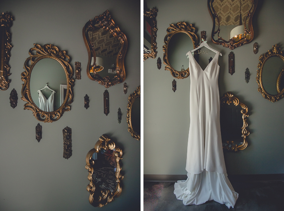 wedding dress hangs among small mirrors at Salon Elizabeth in Buffalo, NY