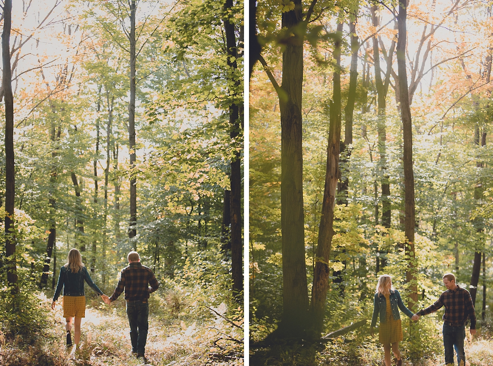 bride and groom walk while holding hands during wedding engagement photos among fall foliage at their property in Ellicottville, NY