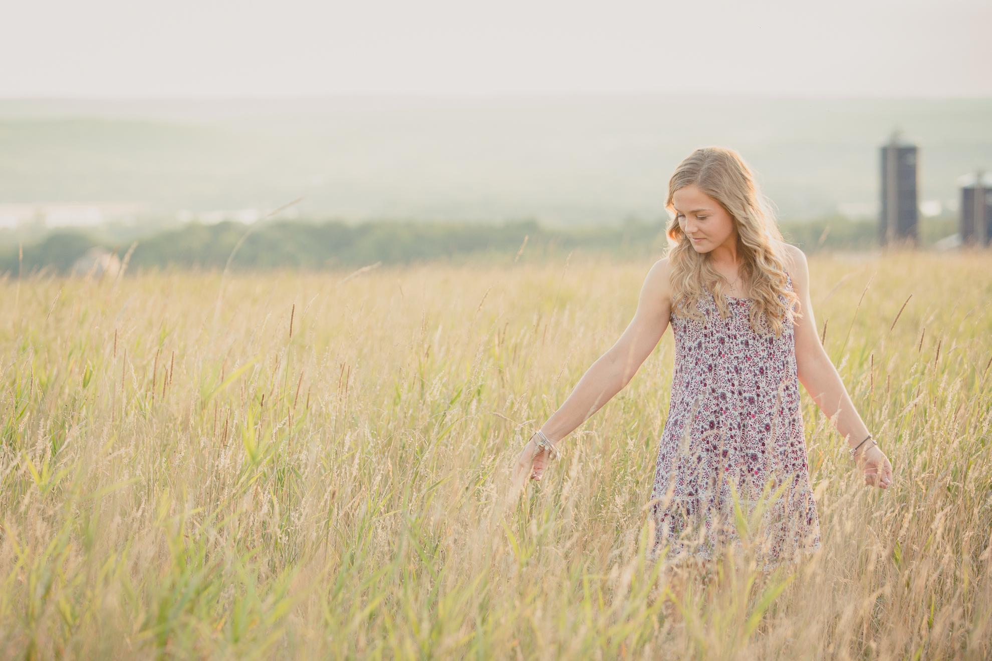 senior portrait photography of Dana in field near Buffalo, NY
