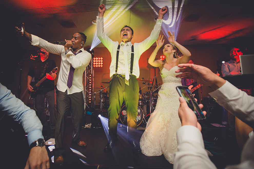 groom and bride sing with best wedding band Radio Tokyo at Buffalo Niagara Convention Center