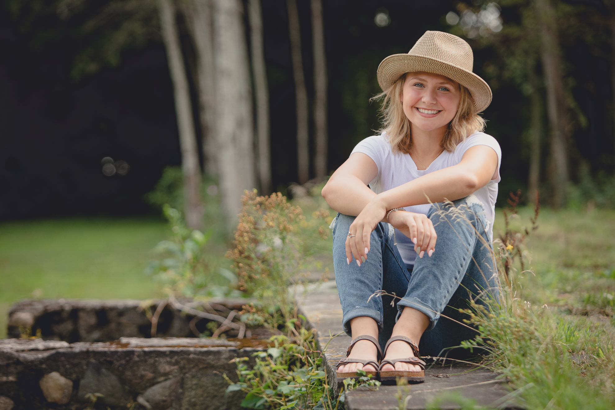 WNY senior smiles for photographer during portrait session at Long Point State Park on Lake Chautauqua in Bemus Point, NY