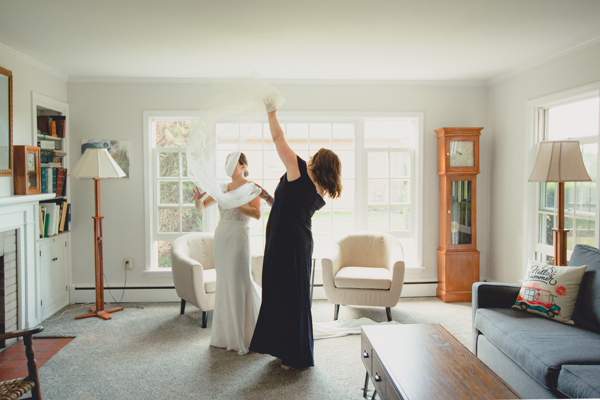 matron of honor helps bride with veil before micro wedding in WNY
