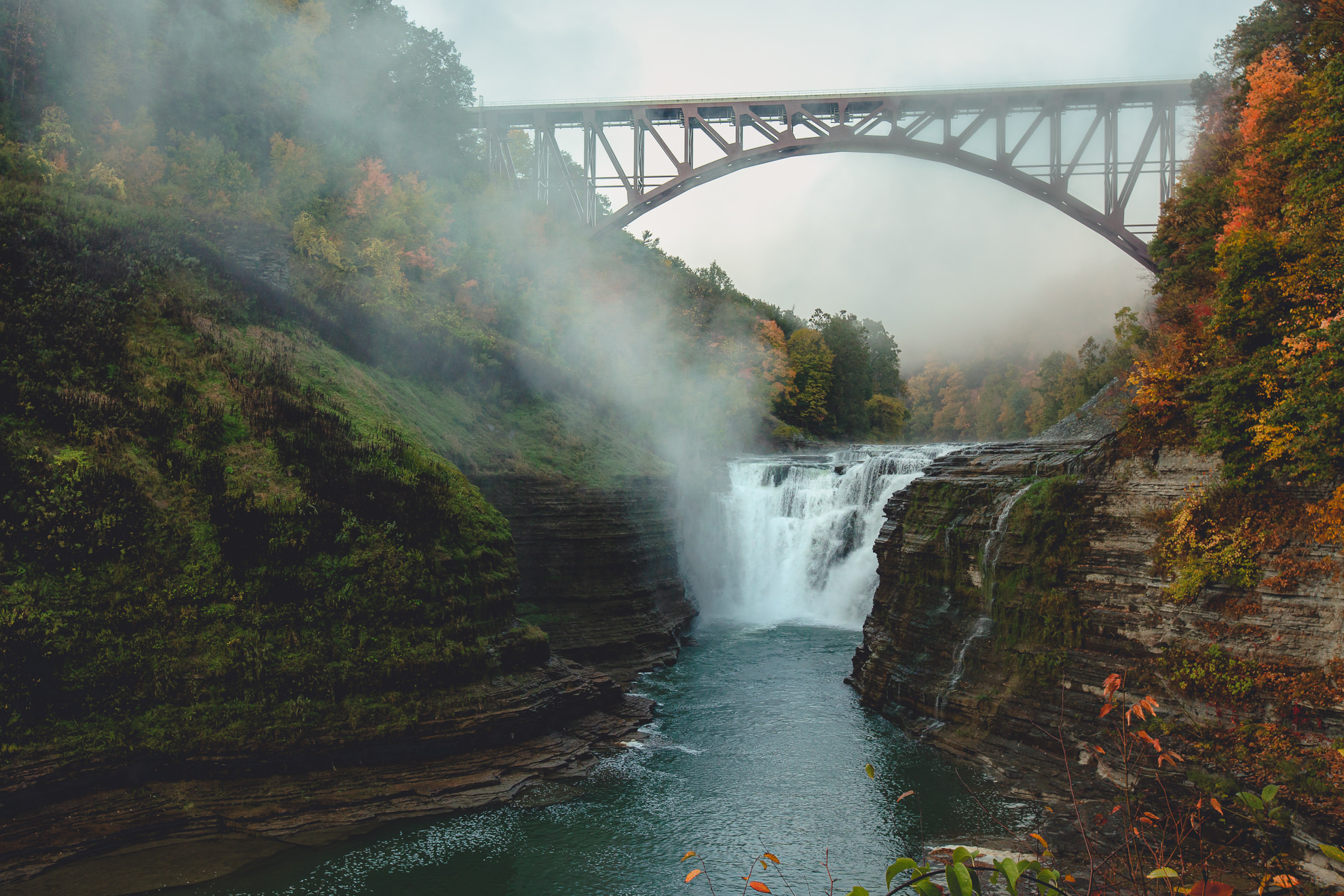 upper falls with fog during wedding engagement proposal photography session in Letchworth State Park