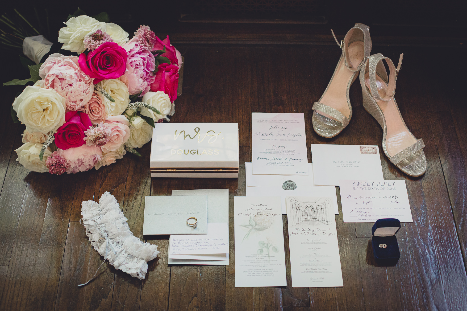 wedding invitation suite, flowers, shoes and jewelry displayed before wedding in Lewiston, NY